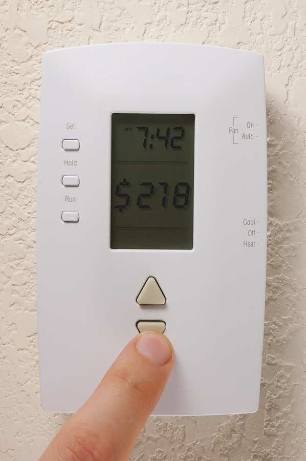 Thermostat showing energy saved