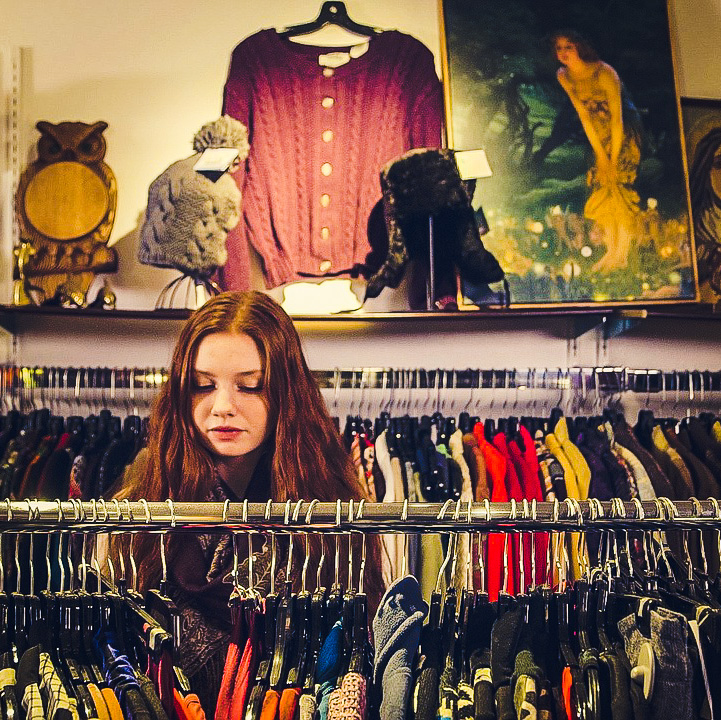 Picture of woman shopping at a thrift store back to school